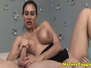 Bigtitted milf jerking on dick..