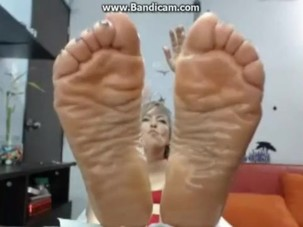Older Colombiana oiled feet..