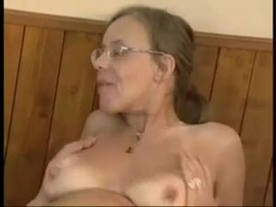 Mature lady with glasses has sex.