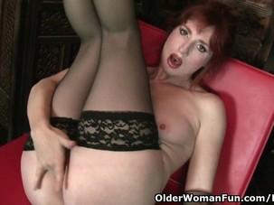 Redheaded milf Amber Dawn looks..