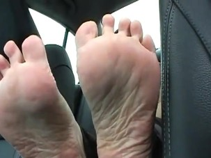 Mature feet in car