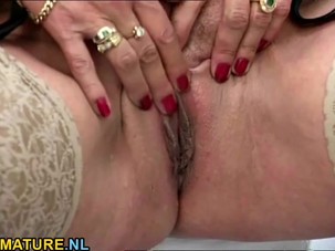 Redhead mature masturbates in..