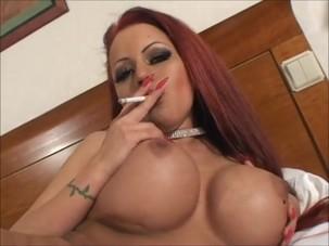 Sexy big tit smoking redhead..